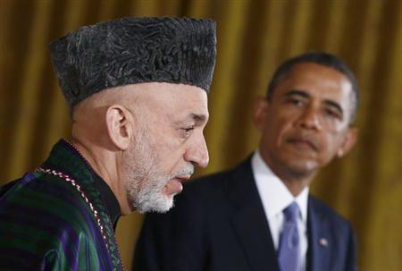Afghan President Hamid Karzai (L) addresses a joint news conference with U.S. President Barack Obama in the East Room of the White House in Washington, January 11, 2013. REUTERS/Jason Reed