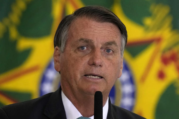 FILE - In this Sept. 15, 2021 file photo, Brazilian President Jair Bolsonaro attends a housing program launch ceremony at the Planalto presidential palace, in Brasilia, Brazil. A group of climate lawyers called Tuesday, Oct. 12, 2021 for the International Criminal Court to launch an investigation into Brazil's president for possible crimes against humanity for his administration's Amazon policies. (AP Photo/Eraldo Peres, file)