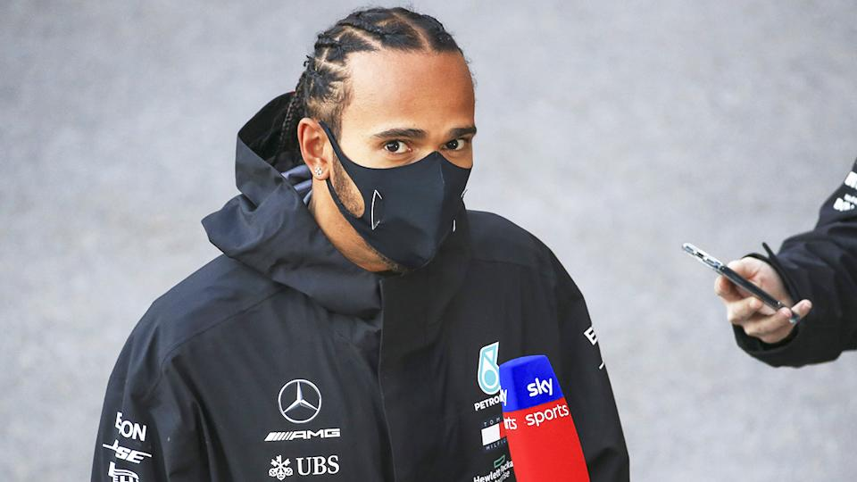 Lewis Hamilton (pictured) looks up during an interview at the Turkish GP.