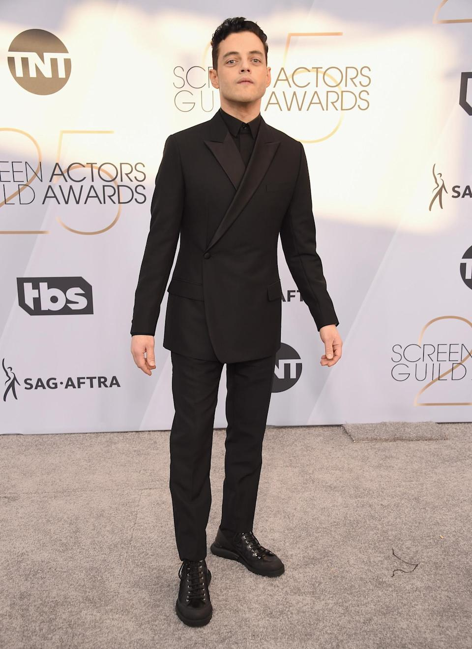 <p><em>Bohemian Rhapsody</em> star and nominee Rami Malek looked put together at the 2019 Annual Screen Actors Guild Awards in Los Angeles. (Photo: Getty Images) </p>