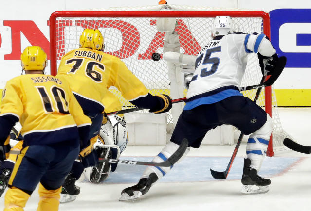 Winnipeg Jets center Paul Stastny (25) scores a goal ahead of Nashville Predators defenseman P.K. Subban (76) during the second period in Game 1 of an NHL hockey second-round playoff series Friday, April 27, 2018, in Nashville, Tenn. (AP Photo/Mark Humphrey)