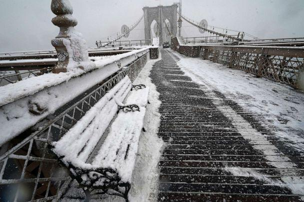 PHOTO: A snowplow clears the wooden pedestrian walkway on the Brooklyn Bridge, Feb. 7, 2021, in New York. (Kathy Willens/AP)