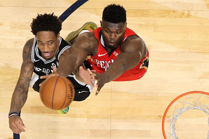 """Neither <a class=""""link rapid-noclick-resp"""" href=""""/nba/players/4614/"""" data-ylk=""""slk:DeMar DeRozan"""">DeMar DeRozan</a>'s Spurs nor <a class=""""link rapid-noclick-resp"""" href=""""/nba/players/6163/"""" data-ylk=""""slk:Zion Williamson"""">Zion Williamson</a>'s Pelicans can afford a loss on Sunday. They play each other. (Chris Graythen/Getty Images)"""