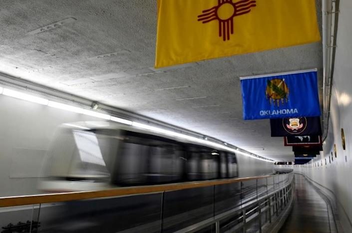 The track stretches 3,100 feet -- a shade under a kilometer -- with a 90-second hop between stations (AFP/Olivier DOULIERY)