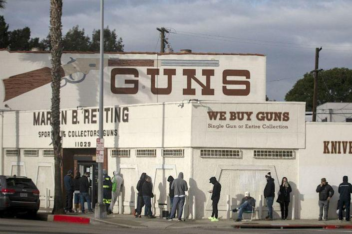 A line at the Martin B. Retting gun store in Culver City on Sunday extends out the door and around the corner.