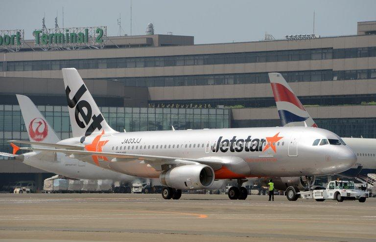 Asian low cost carrier JetStar's airbus jetliner taxies at the Narita International airport on July 19, 2012, Tokyo