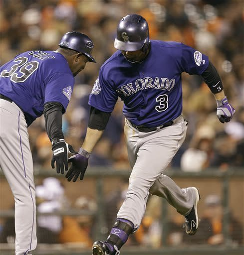 Colorado Rockies' Michael Cuddyer, right, is congratulated by third base coach Stu Cole after hitting a home run off San Francisco Giants' Tim Lincecum in the sixth inning of a baseball game Friday, May 24, 2013, in San Francisco. (AP Photo/Ben Margot)