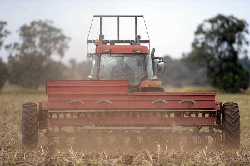 Dairy farmer Jamie Watts sows barley on his property on the Darling Downs, Queensland.