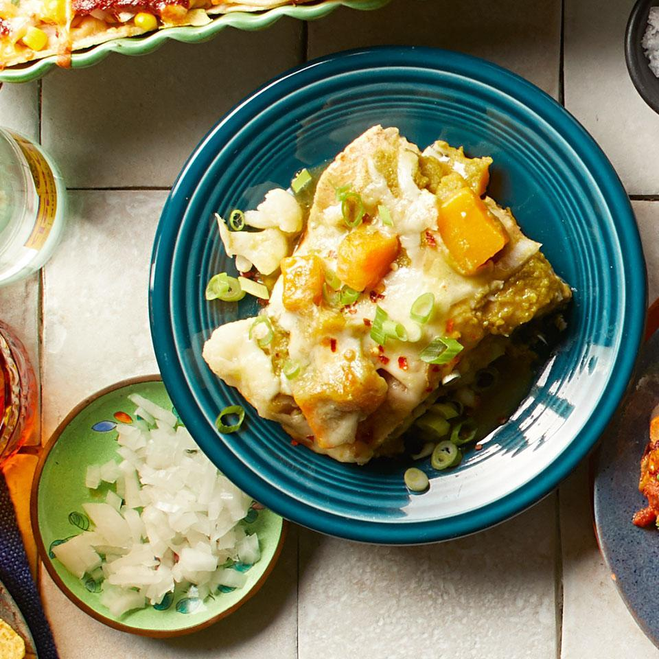 """<p>The butternut squash and cauliflower in these easy layered enchiladas are frozen and don't need to be thawed, making this a healthy and quick dinner. Look for canned tomatillos, sometimes labeled green tomatoes, in the international aisle of your grocery store. <a href=""""http://www.eatingwell.com/recipe/268709/butternut-squash-cauliflower-enchiladas/"""" rel=""""nofollow noopener"""" target=""""_blank"""" data-ylk=""""slk:View recipe"""" class=""""link rapid-noclick-resp""""> View recipe </a></p>"""