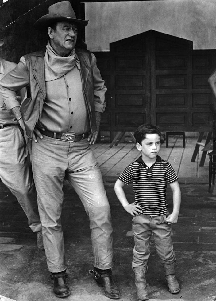 <p>Clearly, John Wayne's son picked up a thing or two from his father about being a cowboy after visiting sets like <em>War Wagon </em>during his childhood. Just look at that expert pose!</p>