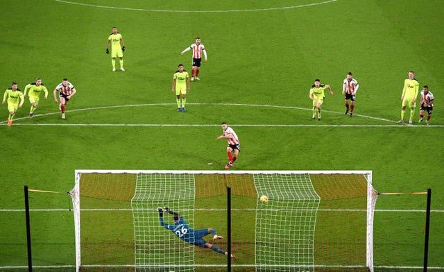 Billy Sharp scores the winning penalty