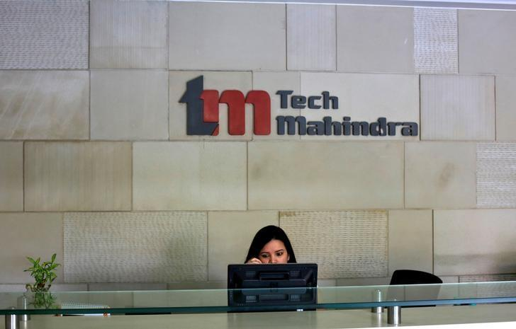 FILE PHOTO: An employee sits at the front desk inside Tech Mahindra office building in Noida