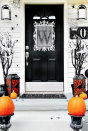 """<p>This door decoration is incredibly fashionable—and only a little bit eerie. It's a cool, understated way to get into the spirit of the season.</p><p><strong>Get the tutorial at <a href=""""https://thistlewoodfarms.com/four-ideas-for-inexpensive-halloween-door-decorations/"""" rel=""""nofollow noopener"""" target=""""_blank"""" data-ylk=""""slk:Thistlewood Farms"""" class=""""link rapid-noclick-resp"""">Thistlewood Farms</a>.</strong></p><p><strong><a class=""""link rapid-noclick-resp"""" href=""""https://go.redirectingat.com?id=74968X1596630&url=https%3A%2F%2Fwww.walmart.com%2Fip%2FHalloween-Artificial-Pumpkin-Simulation-Fake-Lifelike-Props-Garden-Home-Decor%2F371789666&sref=https%3A%2F%2Fwww.thepioneerwoman.com%2Fholidays-celebrations%2Fg32894423%2Foutdoor-halloween-decorations%2F"""" rel=""""nofollow noopener"""" target=""""_blank"""" data-ylk=""""slk:SHOP FAUX PUMPKINS"""">SHOP FAUX PUMPKINS</a></strong></p>"""