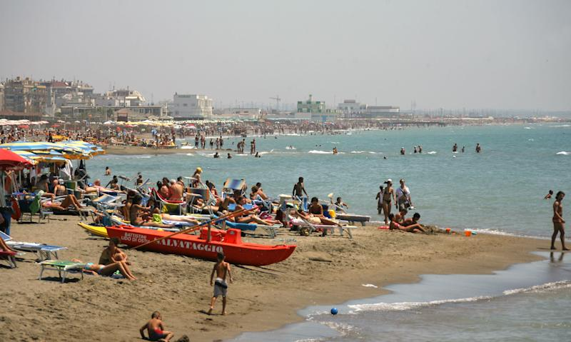 A picture taken July 28, 2007 shows people on a beach in Lido di Ostia, Italy