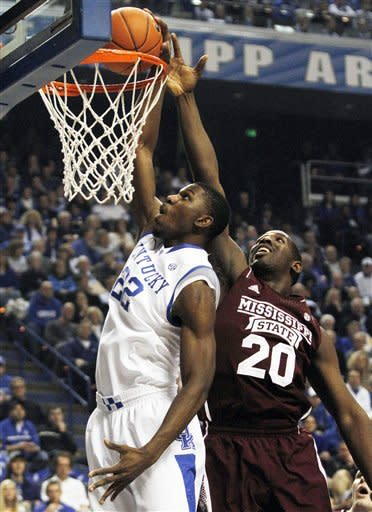 Kentucky's Alex Poythress, left, shoots in front of Mississippi State's Gavin Ware during the first half of an NCAA college basketball game at Rupp Arena in Lexington, Ky., Wednesday, Feb. 27, 2013. (AP Photo/James Crisp)