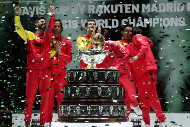 Spain's Rafael Nadal blows confetti off the trophy after Spain defeated Canada 2-0 to win the Davis Cup final in Madrid, Spain, Sunday, Nov. 24, 2019. (AP Photo/Manu Fernandez)