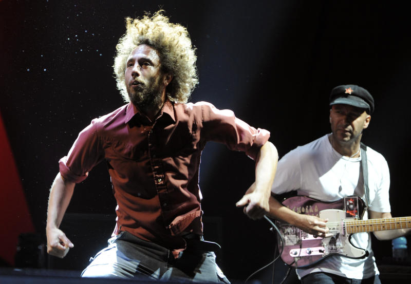 "Zack de la Rocha, left, and Tom Morello of the band Rage Against the Machine perform during their headlining set at the ""L.A. Rising"" concert at the Los Angeles Coliseum, Saturday, July 30, 2011, in Los Angeles. (AP Photo/Chris Pizzello)"