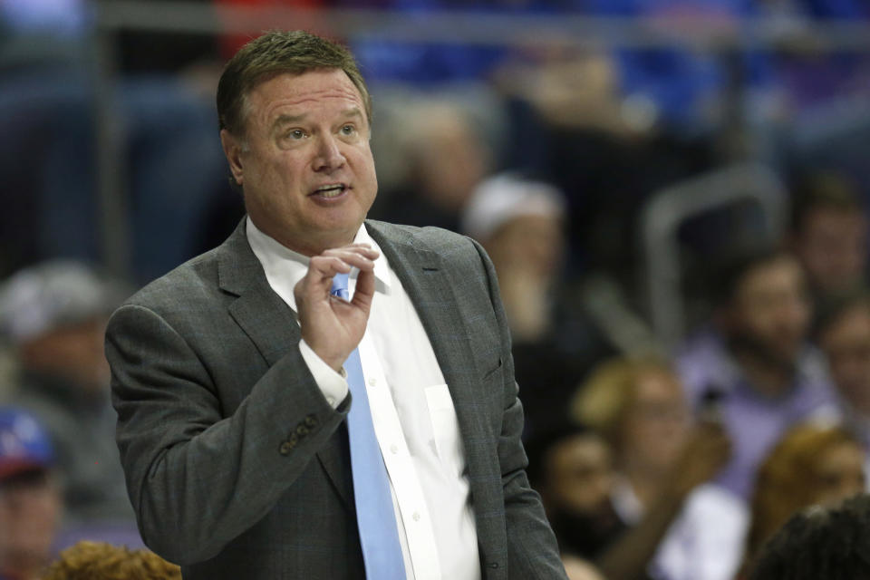 "FILE - In this Feb. 8, 2020, file photo, Kansas head coach Bill Self reacts to a play as Kansas plays TCU during the second half of an NCAA college basketball game in Fort Worth, Texas. The NCAA struck back at the University of Kansas and its men's basketball program Thursday, May 7, 2020 calling five Level I violations that are alleged to have occurred egregious and arguing that they undermine and threaten"" college athletics. (AP Photo/Ron Jenkins, file)"