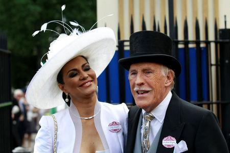 <p>Sir Bruce and his wife Wilnelia Merced arrive for Ladies Day, the third day of racing at Royal Ascot in 2011. (REUTERS) </p>