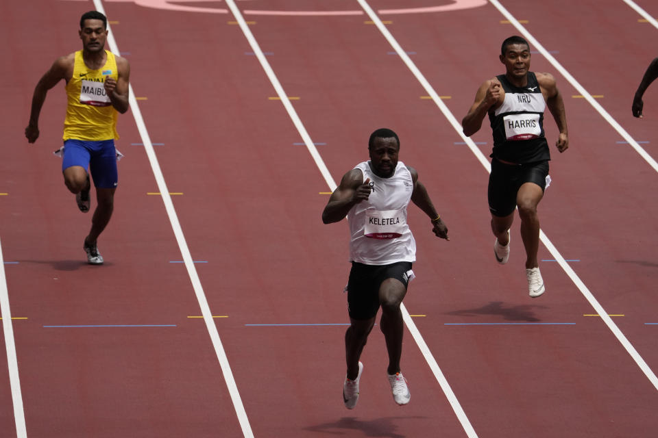 Dorian Keletela, of Refugee Olympic Team, wins a heat in the men's 100-meter run at the 2020 Summer Olympics, Saturday, July 31, 2021, in Tokyo. (AP Photo/Charlie Riedel)