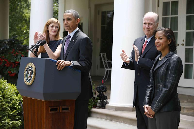 President Barack Obama stands with UN Ambassador Susan Rice, his choice to be his next National Security Adviser, right, current National Security Adviser Tom Donilon, who is resigning, second from right, and Samantha Power, his nominee to be the next UN Ambassador, left, Wednesday, June 5, 2013, in the Rose Garden at the White House in Washington, where he made the announcement. (AP Photo/Charles Dharapak)
