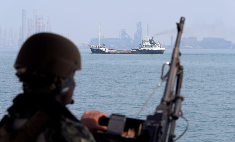FILE PHOTO: A U.S. Navy soldier onboard Mark VI Patrol Boat stands guard during an exercise of U.S./UK Mine Countermeasures (MCMEX) taking place in Arabian Sea