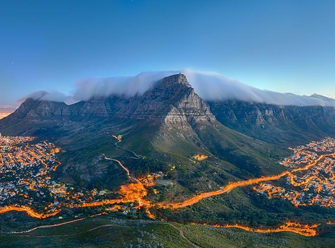 """<p>The most iconic landscape in South Africa, Table Mountain looks over <a href=""""https://www.purewow.com/travel/Guide-to-Cape-Town"""" rel=""""nofollow noopener"""" target=""""_blank"""" data-ylk=""""slk:Cape Town"""" class=""""link rapid-noclick-resp"""">Cape Town</a> from 3,558 feet above the sea. You can see its flat peak from almost anywhere in the city, often surrounded by clouds.</p>"""