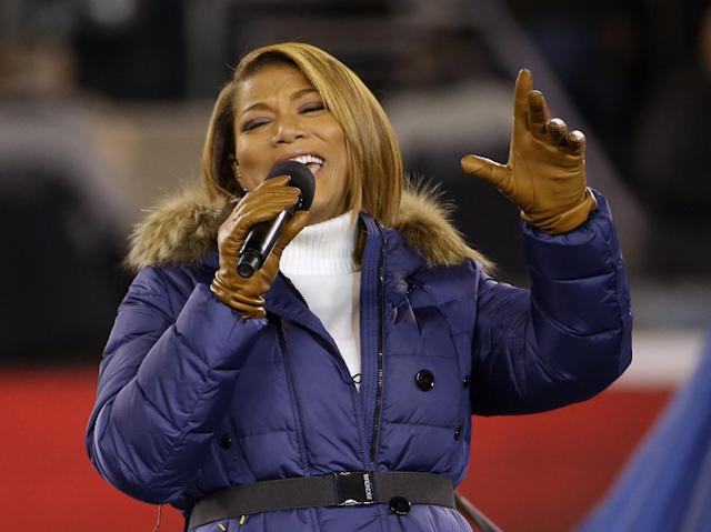 "Queen Latifah sings ""America the Beautiful"" before the NFL Super Bowl XLVIII football game between the Seattle Seahawks and the Denver Broncos Sunday, Feb. 2, 2014, in East Rutherford, N.J. (AP Photo/Matt Slocum)"