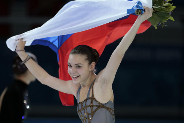 Adelina Sotnikova of Russia celebrates winning the women's free skate figure skating finals following the flower ceremony at the Iceberg Skating Palace during the 2014 Winter Olympics, Thursday, Feb. 20, 2014, in Sochi, Russia. (AP Photo/Ivan Sekretarev)