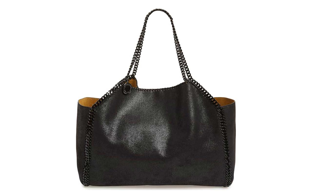 """<p>Stella McCartney has been leading the charge on sustainable high fashion since she first launched the brand. All of her bags are made from 100 percent vegan materials and are the ultimate proof that luxury and sustainability can go hand-in-hand. Also reversible to a golden suede-like material, this roomy tote is the perfect investment travel bag.</p> <p>To buy: <a href=""""https://click.linksynergy.com/deeplink?id=93xLBvPhAeE∣=1237&murl=http%3A%2F%2Fshop.nordstrom.com%2Fs%2Fstella-mccartney-reversible-faux-leather-tote%2F4962056&u1=TL,9StylishVeganLeatherBagsThatLookLiketheRealThing,chenk,TRA,GAL,753769,201903,I"""" target=""""_blank"""">nordstrom.com</a>, $1,250</p>"""
