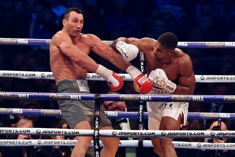 Britain's Anthony Joshua (right) throws a punch at Ukraine's Wladimir Klitschko during their world heavyweight title fight at Wembley Stadium, in London, in April 2017