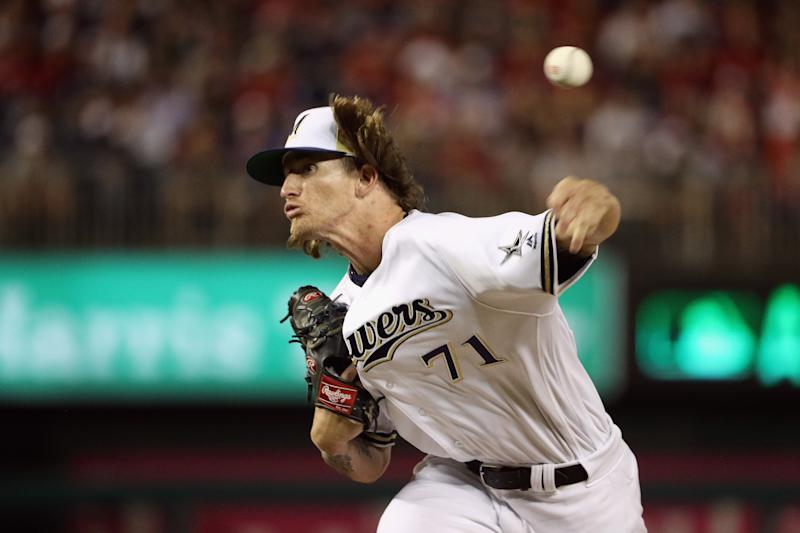 Josh Hader pitches in the eighth inning of the All-Star Game. He later apologized for hate-filled tweets from his past that resurfaced. (Patrick Smith via Getty Images)