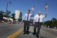 Congressman Sandy Levin left and his brother former Sen. Carl Levin march during Clawson's Annual 4th of July parade on 14 Mile Road on July 4, 2014.