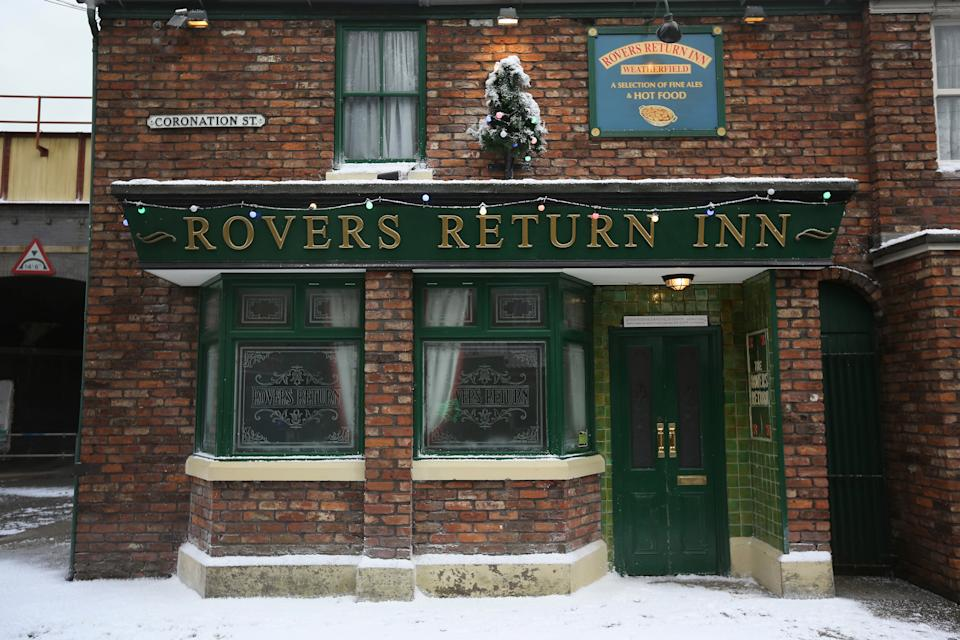 The famous Rovers Return is decorated for Christmas as the set of television soap Coronation St is covered in fake snow for the festive season for 'Christmas on the Cobbles' on November 21, 2014 in Manchester, England. Christmas on the street has been celebrated for 53 years since the first ever episode was screened. Visitors to the former Granada TV studios can now sample the festive atmosphere during their tour as the sets are decorated as they would be in the soap opera. The former studios at Granada Television have been turned into a visitor attraction since production of Coronation St moved to modern facilities in Salford. The attractions Christmas theme will be open between November 22nd and January 11th 2015.  (Photo by Christopher Furlong/Getty Images)