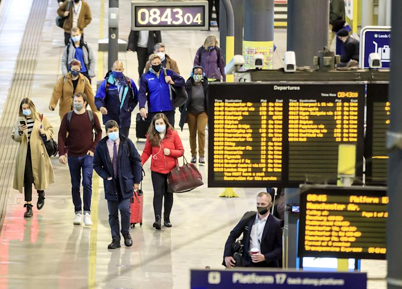 Commuters at Leeds railway station. Train services will be ramped up from today as schools in England and Wales reopen and workers are encouraged to return to offices. (Photo by Danny Lawson/PA Images via Getty Images)