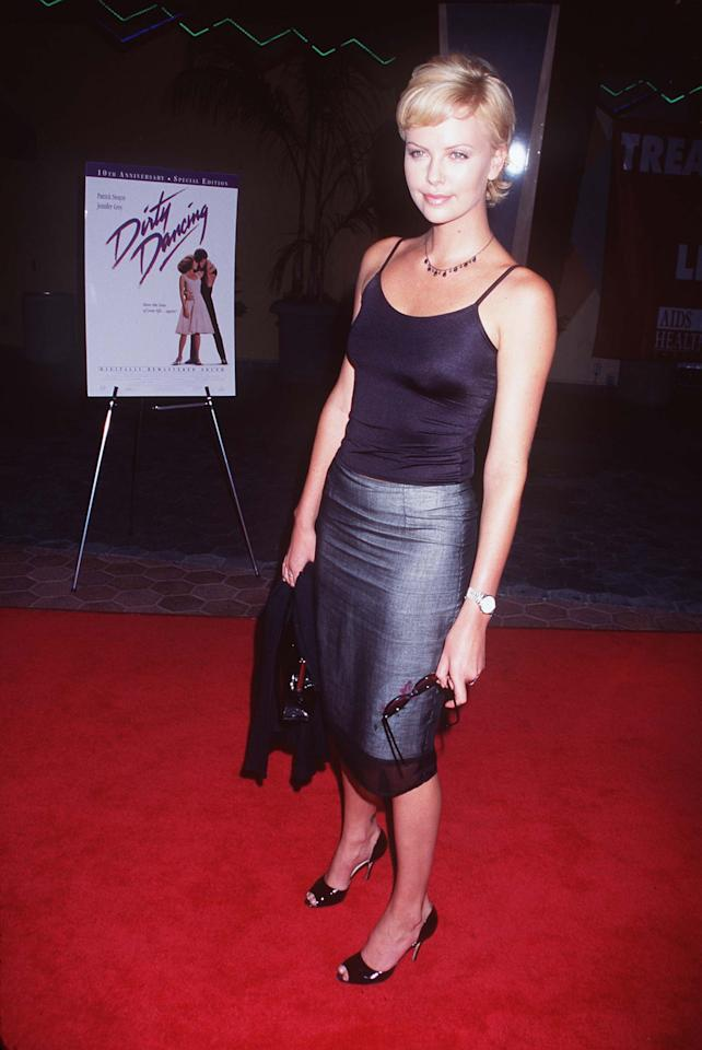 <p>A classic 1997 pairing. It worked for the office, casual outings, and, in Theron's case, the red carpet.</p>