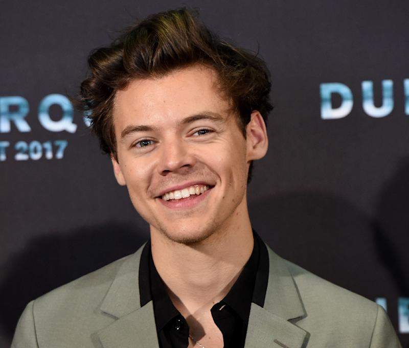 """British singer Harry Styles poses during a photocall in the French city of Dunkirk for the premiere of the film """"Dunkirk"""""""