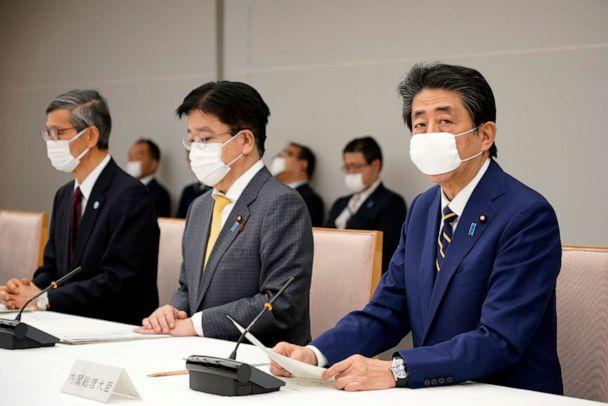 PHOTO: Japanese Prime Minister Shinzo Abe, right, declares a state of emergency for seven prefectures during a meeting of the task force against the novel coronavirus outbreak at the his official residence in Tokyo, April 7, 2020. (Franck Robichon/Pool Photo via AP)