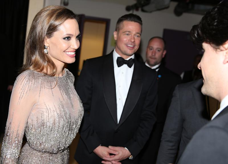 Angelina Jolie, left, and Brad Pitt appear at the Oscars on Sunday, March 2, 2014, at the Dolby Theatre in Los Angeles.  (Photo by Matt Sayles/Invision/AP)