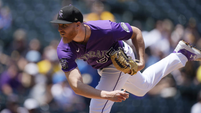 Colorado Rockies starting pitcher Jon Gray works against the Pittsburgh Pirates in the first inning of a baseball game Wednesday, June 30, 2021, in Denver. (AP Photo/David Zalubowski)