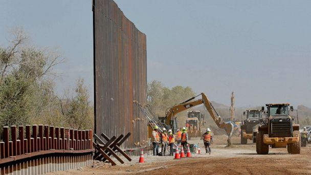 PHOTO: In this Sept. 10, 2019 file photo government contractors erect a section of Pentagon-funded border wall along the Colorado River in Yuma, Ariz. (Matt York/AP, File)