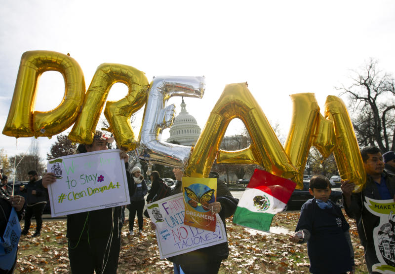 In this Dec. 6, 2017, file photo, demonstrators hold up balloons during an immigration rally in support of the Deferred Action for Childhood Arrivals (DACA), and Temporary Protected Status (TPS), programs, near the U.S. Capitol in Washington.  (AP Photo/Jose Luis Magana, File)