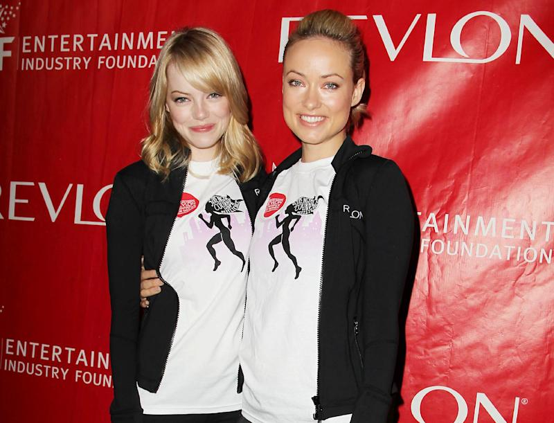 FILE - This May 5, 2012 file photo originally released by Starpix shows actresses Emma Stone, left, Olivia Wilde at the 15th Annual EIF Revlon Run/Walk for Women in New York. Wilde and Stone will return as co-hosts of the 20th annual Revlon Run/Walk for Women in New York on May 4, 2013, and Wilde says Jason Sudeikis may join her for the five-kilometer fundraiser. Revlon and the Entertainment Industry Foundation also announced Monday, April 8, 2013 that expectant mom Halle Berry will host the Los Angeles event for the seventh time. It's set for May 11. (AP Photo/Starpix, Amanda Schwab)