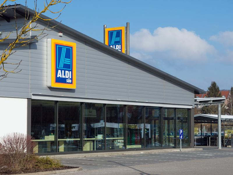Amberg, Germany - February 18, 2018: ALDI store in Amberg, Bavaria, Germany, Europe. ALDI is a german discount market chain with headquarter in Mühlheim an der Ruhr, Germany. Logo of ALDI SÜD on the facade. Sunday morning - no people in the store.