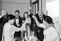 """The traditional <em>pyebaek</em> is pretty solemn and serious, but that's just not either of us or our families. We played """"Gangnam Style"""" in the background and all four parents cheered with Korean rice wine. This wedding was not only a union of Amit and I, but of our families as well."""