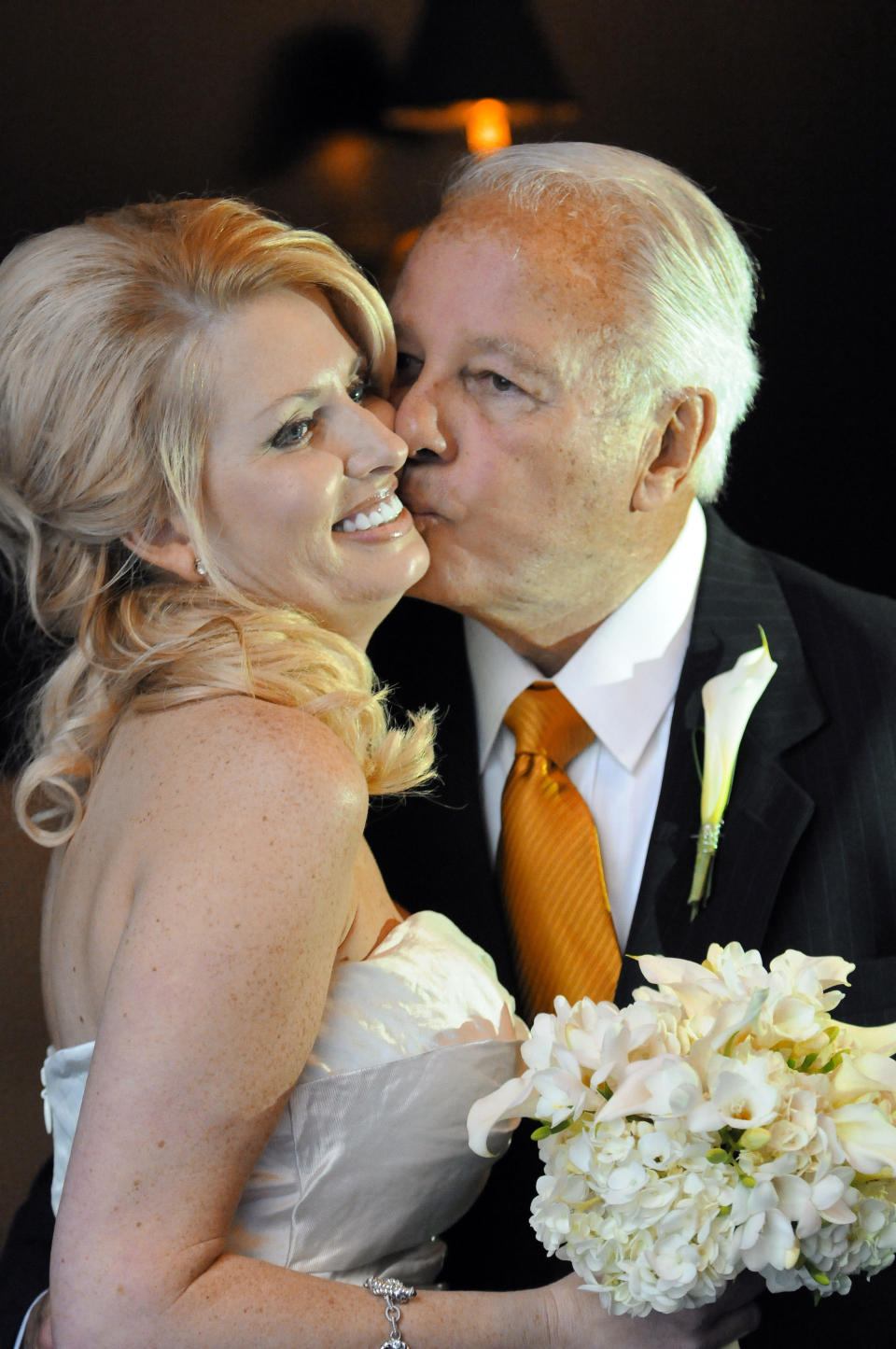 FILE - In this July 29, 2011, file photo, former Governor Edwin Edwards, right, kisses his new bride, Trina Grimes Scott, after a ceremony in the French Quarter in New Orleans, La. Edwin Washington Edwards, the high-living four-term governor whose three-decade dominance of Louisiana politics was all but overshadowed by scandal and an eight-year federal prison stretch, died Monday, July 12, 2021 . He was 93. Edwards died of respiratory problems with family and friends by his bedside, family spokesman Leo Honeycutt said. He had suffered bouts of ill health in recent years and entered hospice care this month at his home in Gonzales, near the Louisiana capital. (AP Photo/Cheryl Gerber, File)