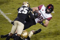 San Diego State tight end Daniel Bellinger, right, is tackled by Colorado safety Derrion Rakestraw, bottom left, and cornerback Mekhi Blackmon in the second half of an NCAA college football game Saturday, Nov. 28, 2020, in Boulder, Colo. (AP Photo/David Zalubowski)