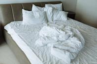 """While you might want to make your bed the second you get out of it in the morning, refraining from doing so can keep you healthier in the long run. The moisture from your body can attract dust mites, says <strong>Jennifer Gregory</strong>, brand manager at <a href=""""https://www.mollymaid.com/"""" rel=""""nofollow noopener"""" target=""""_blank"""" data-ylk=""""slk:Molly Maid"""" class=""""link rapid-noclick-resp"""">Molly Maid</a>. So when in doubt, """"air your sheets out,"""" and only make the bed once they're completely dry."""