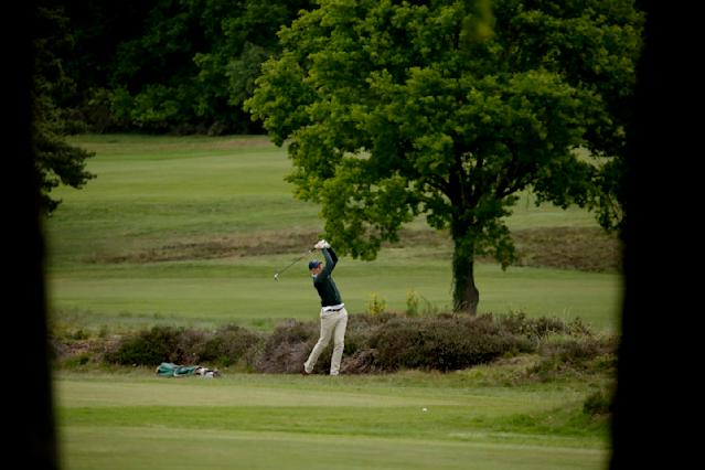 A golfer hits a shot after Sunningdale Golf Club reopened this morning as part of the British government relaxing the coronavirus lockdown measures, in Sunningdale, England, Wednesday, May 13, 2020. Tennis courts and golf courses in England can reopen from Wednesday, the sports venues were ordered to be closed in March when Britain imposed a national lockdown due to the coronavirus outbreak. (AP Photo/Matt Dunham)