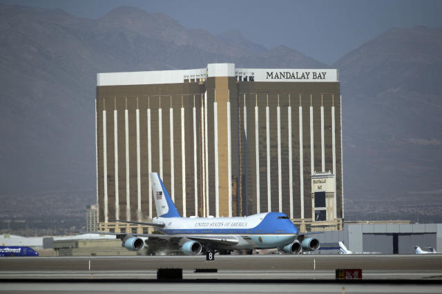 <p>Air Force One carrying President Trump taxis on the runway past Mandalay Bay on Wednesday, Oct. 4, 2017, in Las Vegas. A gunman opened fire on an outdoor music concert on Sunday killing dozens and injuring hundreds. Trump is meeting with victims and first responders in the wake of the tragedy. (Photo: John Locher/AP) </p>